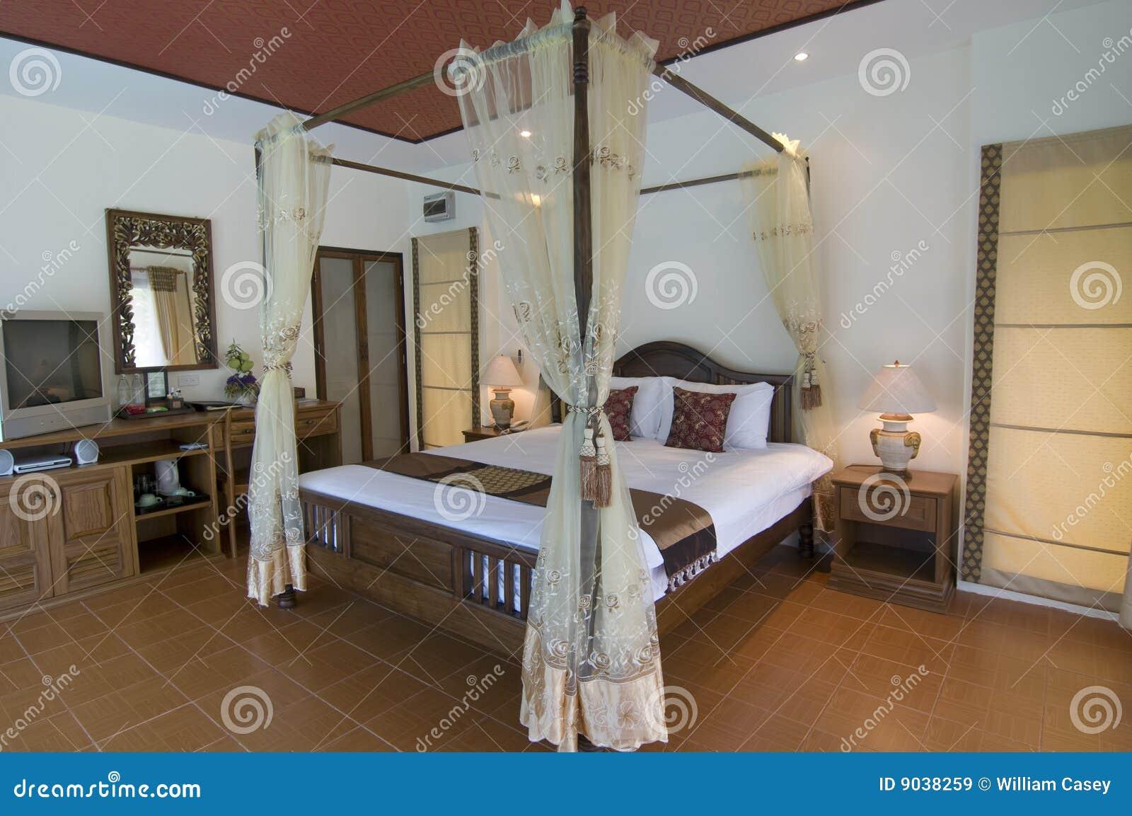 Oosterse stijl tropische slaapkamer stock afbeelding afbeelding