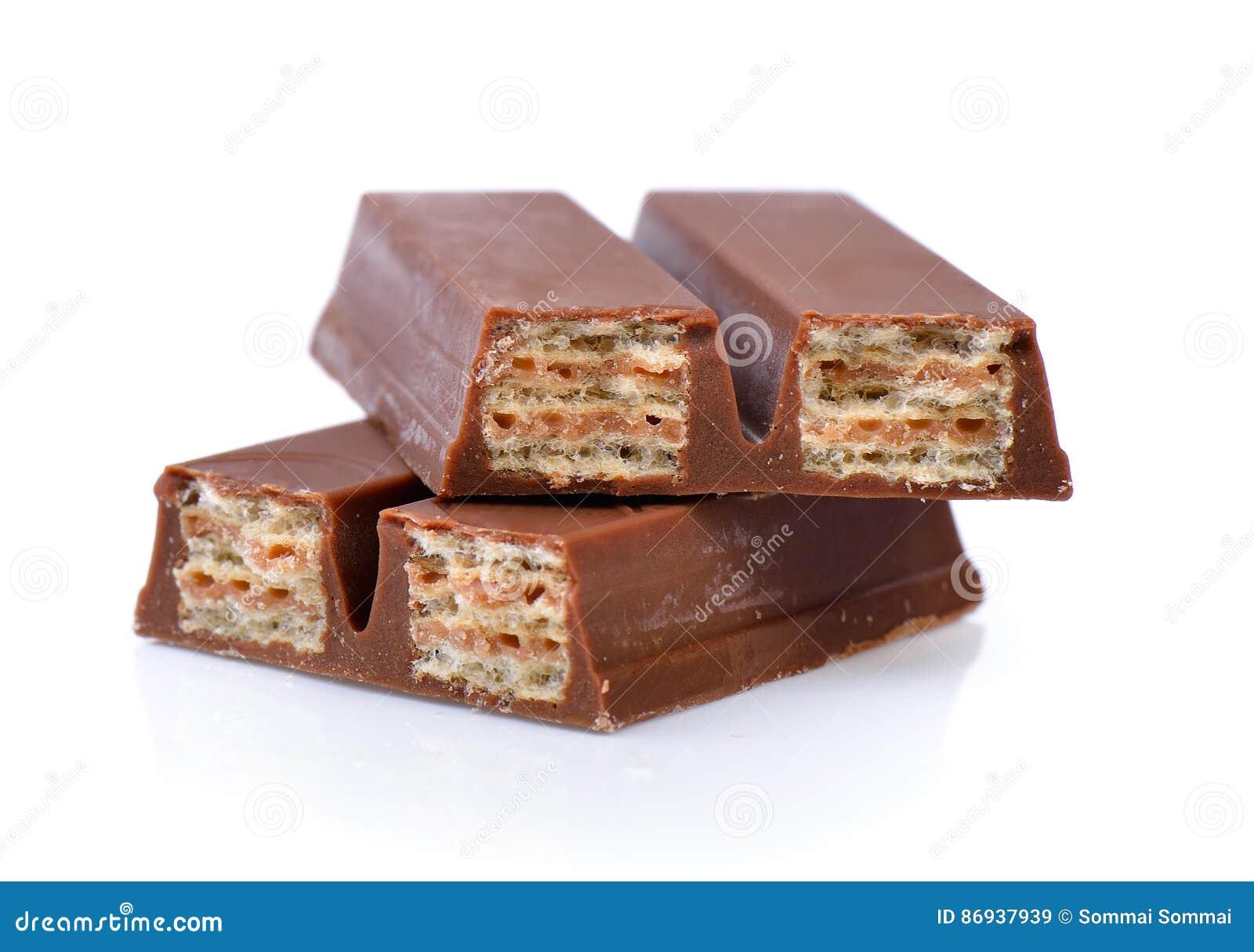 Opłatki w czekoladzie odizolowywającej na białym tle