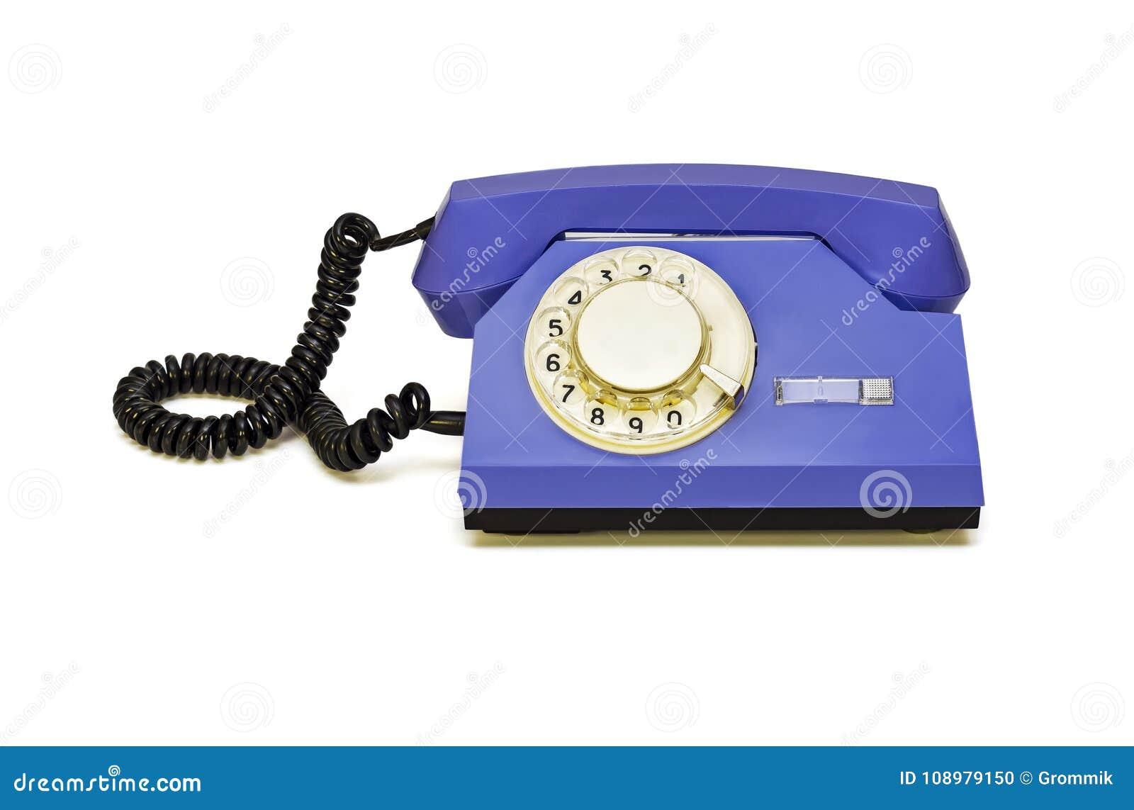 Op witte retro telefoon als achtergrond met rond dialer