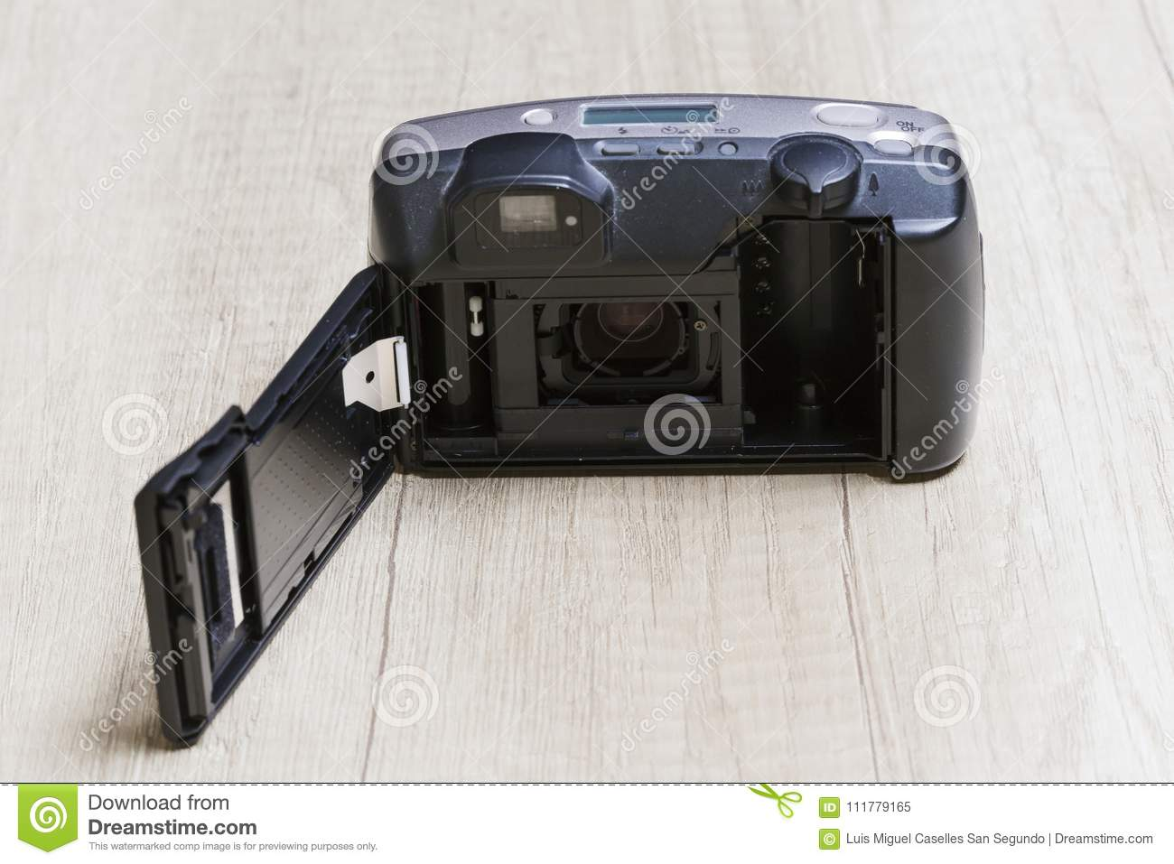 Analog camera open on a wooden board