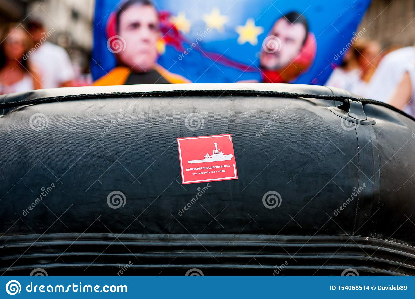 Proactiva open arms ngo sticker on rubber dinghy boat during public protest against italian far right politics and politicians