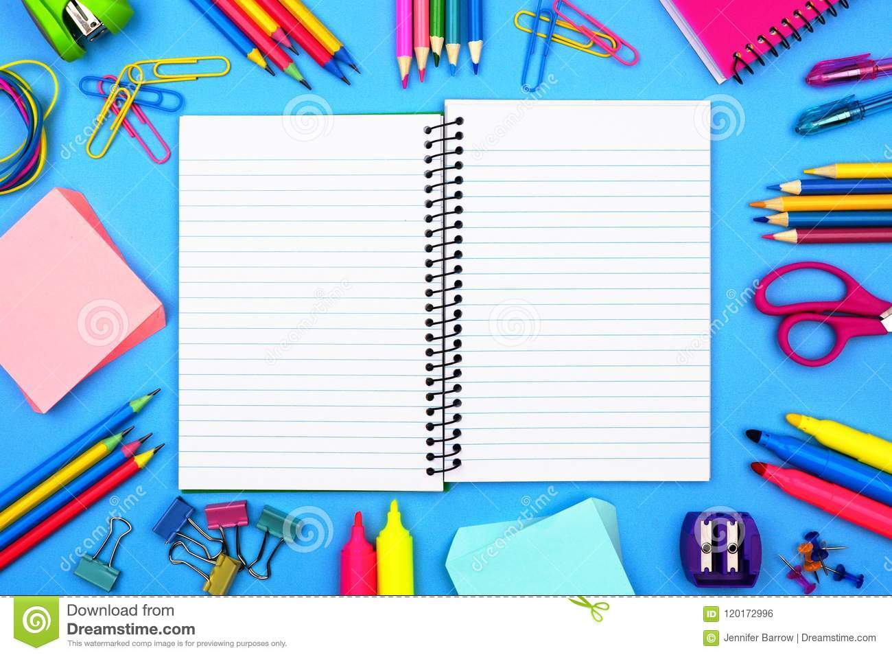 Open, Blank Lined Notebook With School Supplies Frame Over A Blue ...