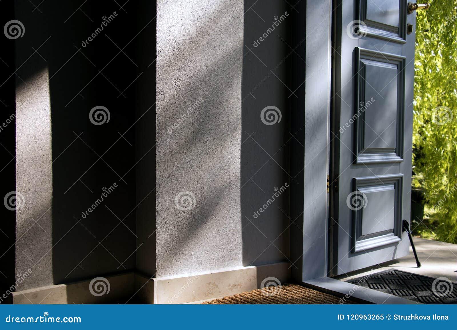 Open blue door into the house.