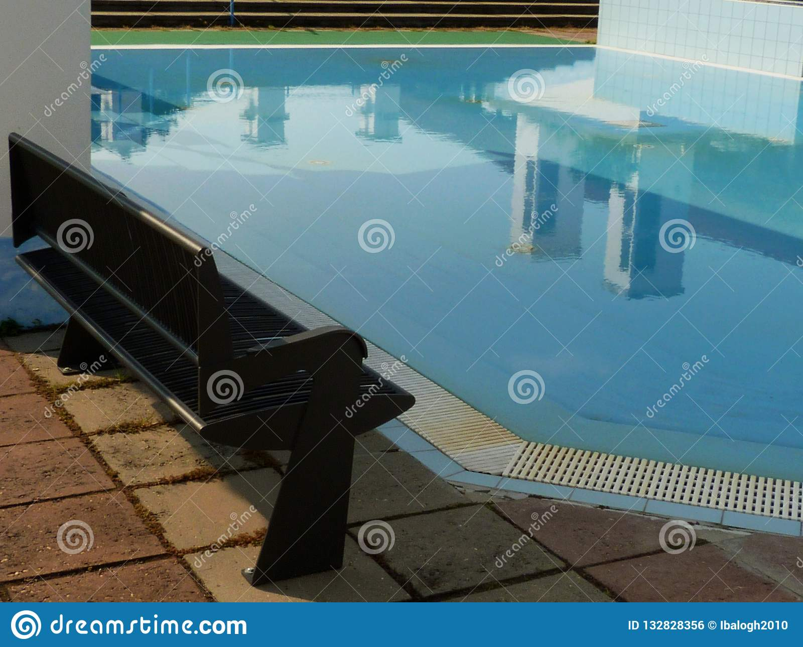 Open Blue Kids` Swimming Pool With Benches And Awnings Stock ...