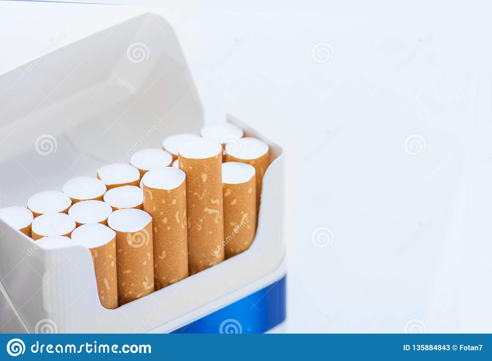 Open blue pack of cigarettes on white