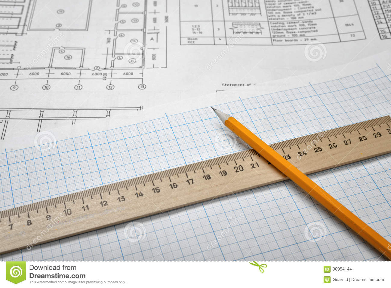 Open blueprints on wooden table background with a pencil and a ruler download comp malvernweather Choice Image