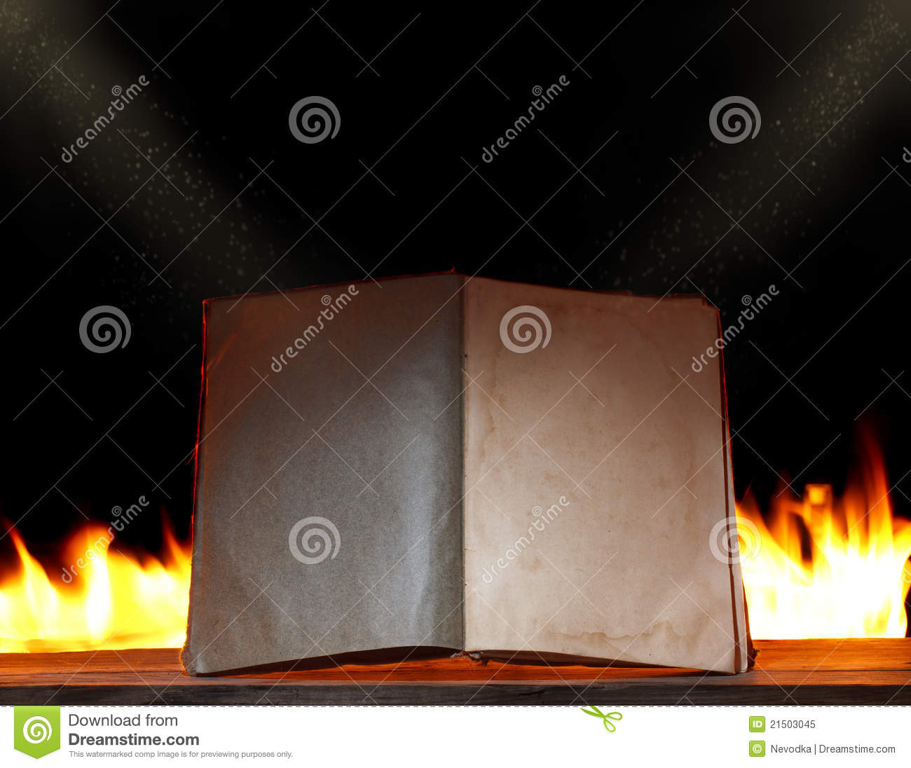 Open book in ambient light with fire