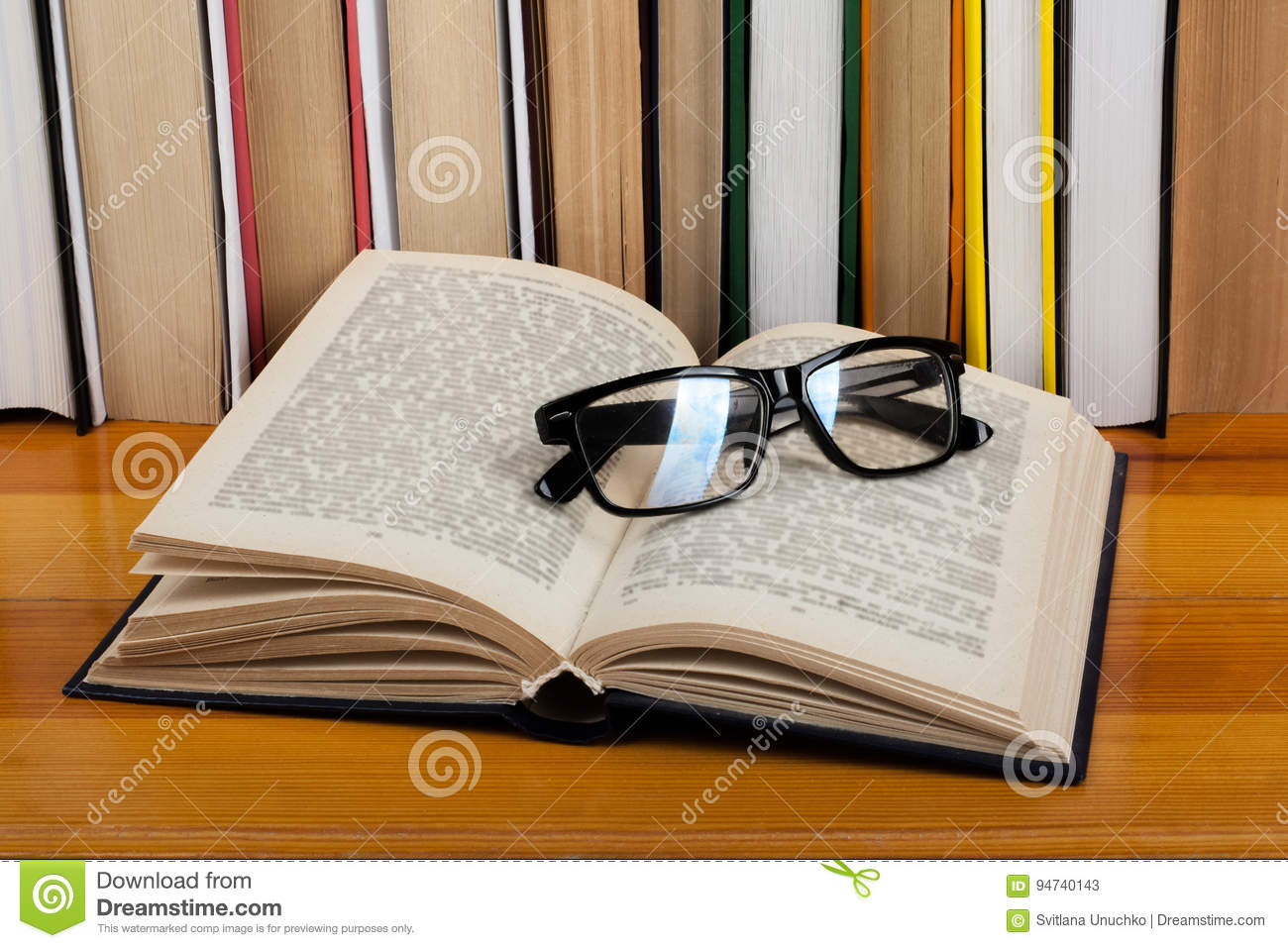 Open Book, Glasses Hardback Colorful Books On Wooden Table