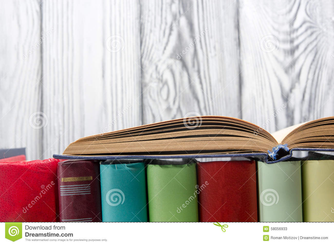 Open book, hardback books on wooden background. Back to school. Copy space