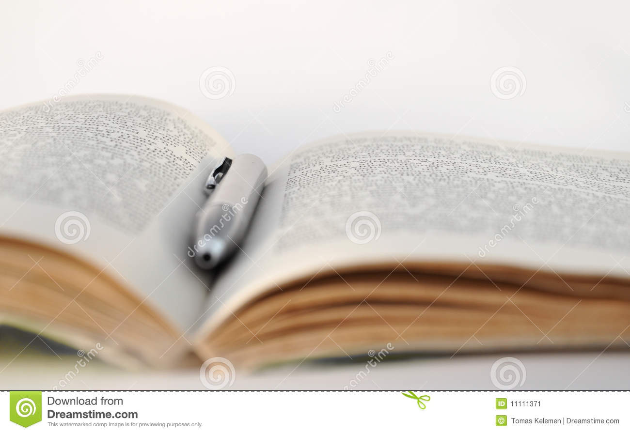 Open book with a pen