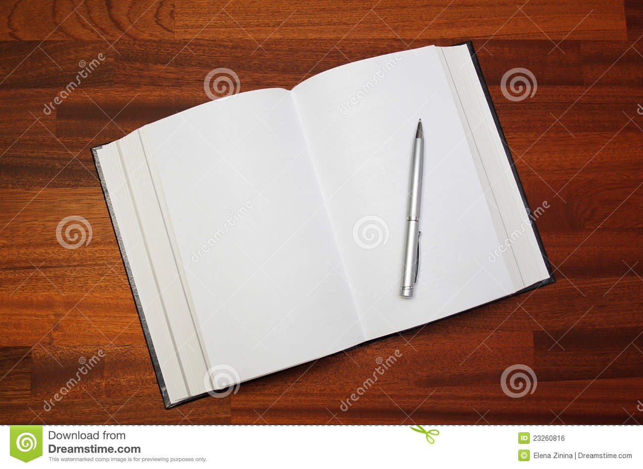 open book and pen on a wooden background table stock photo