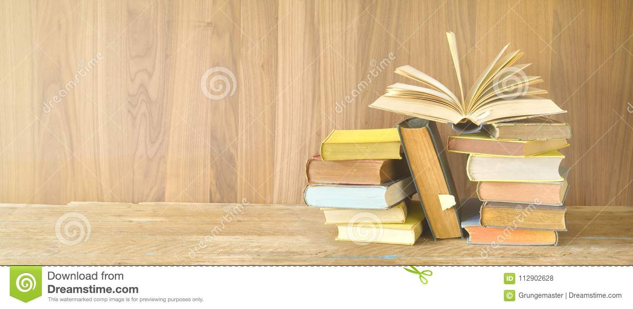 Open Book On A Pile Of Old Books, Panoarma, Good Copy Space Stock