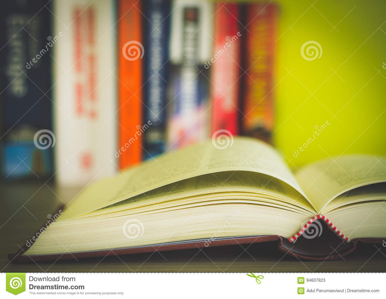 Open book, stack of colorful hardback books isolated on white background. Back to school. Copy space for text. Toned image