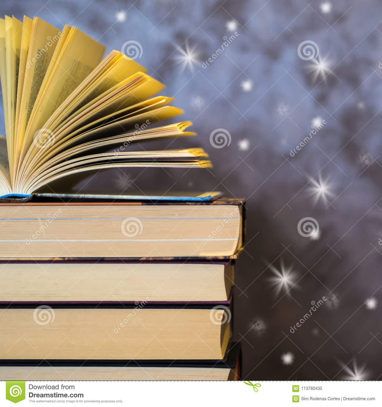 Open Book On Top Of Other Books Stock Image - Image of
