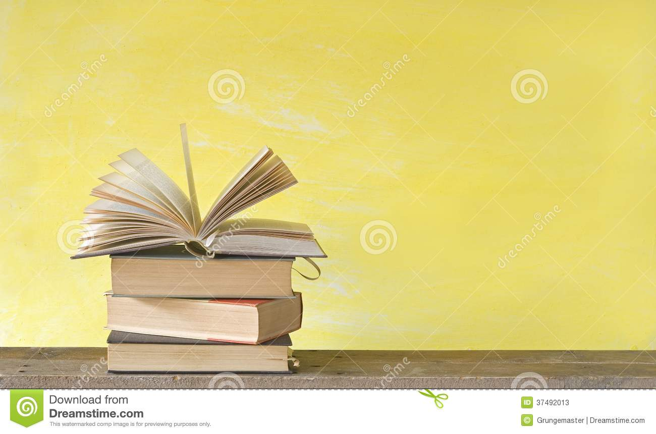 Open Book On Yellow Background Free Copy Space Stock