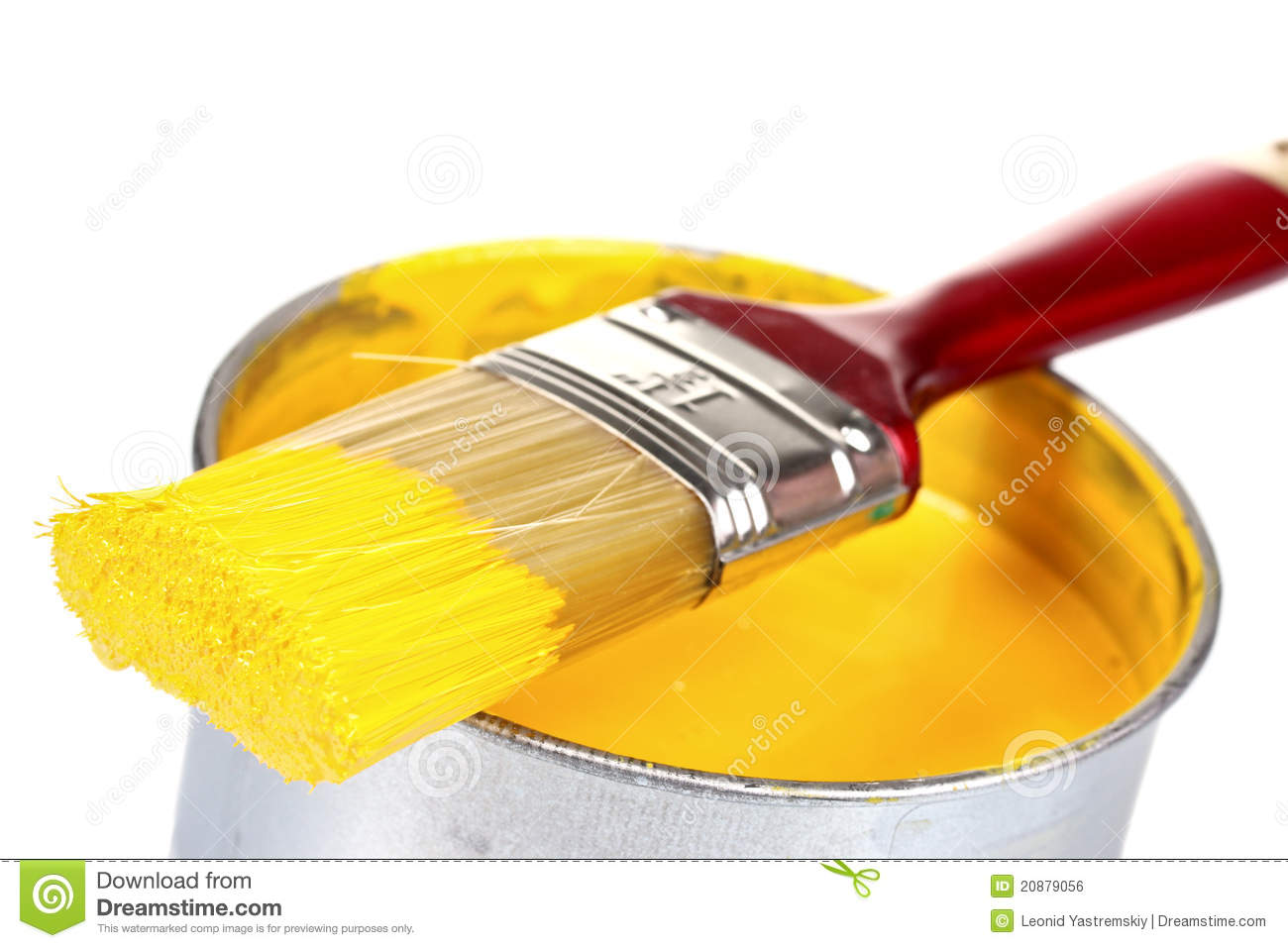 Open can of yellow paint and brush stock photo image for White paint going yellow