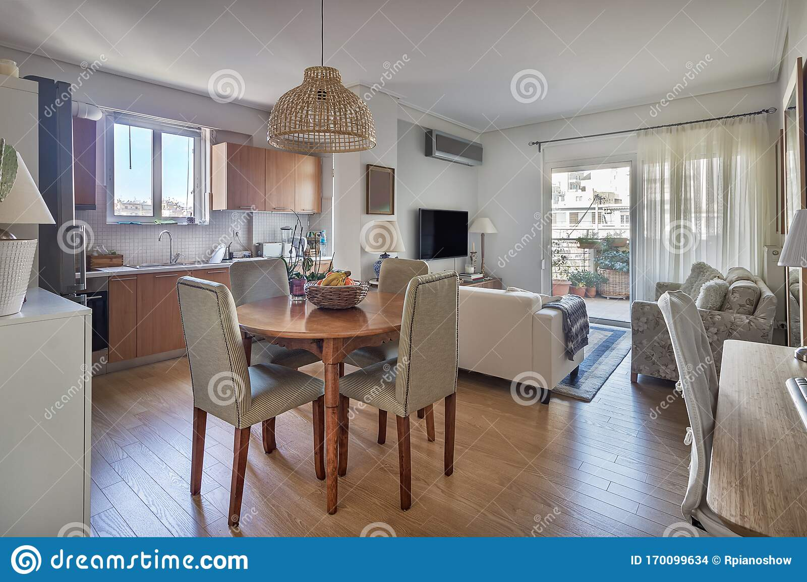 Open Concept Of A Kitchen Dining Wooden Table And Living Room Stock Photo Image Of Interior Open 170099634