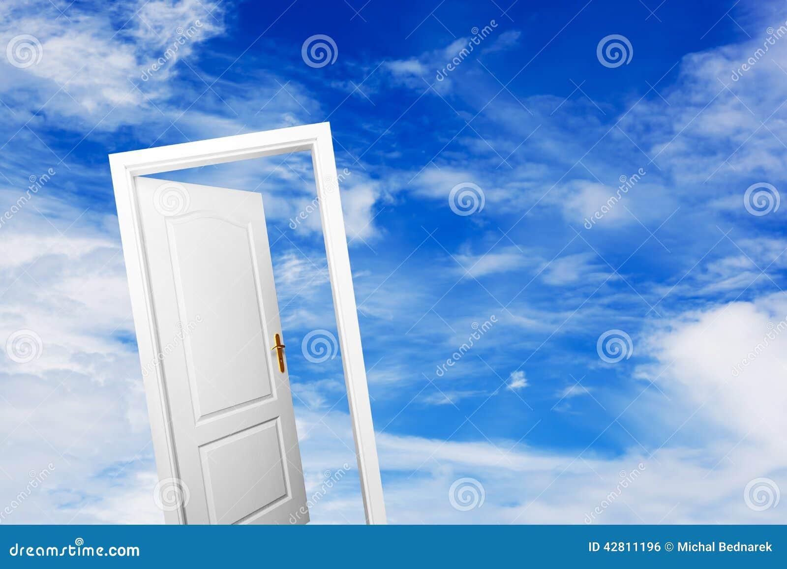 Open door on blue sunny sky. New life, success, hope.