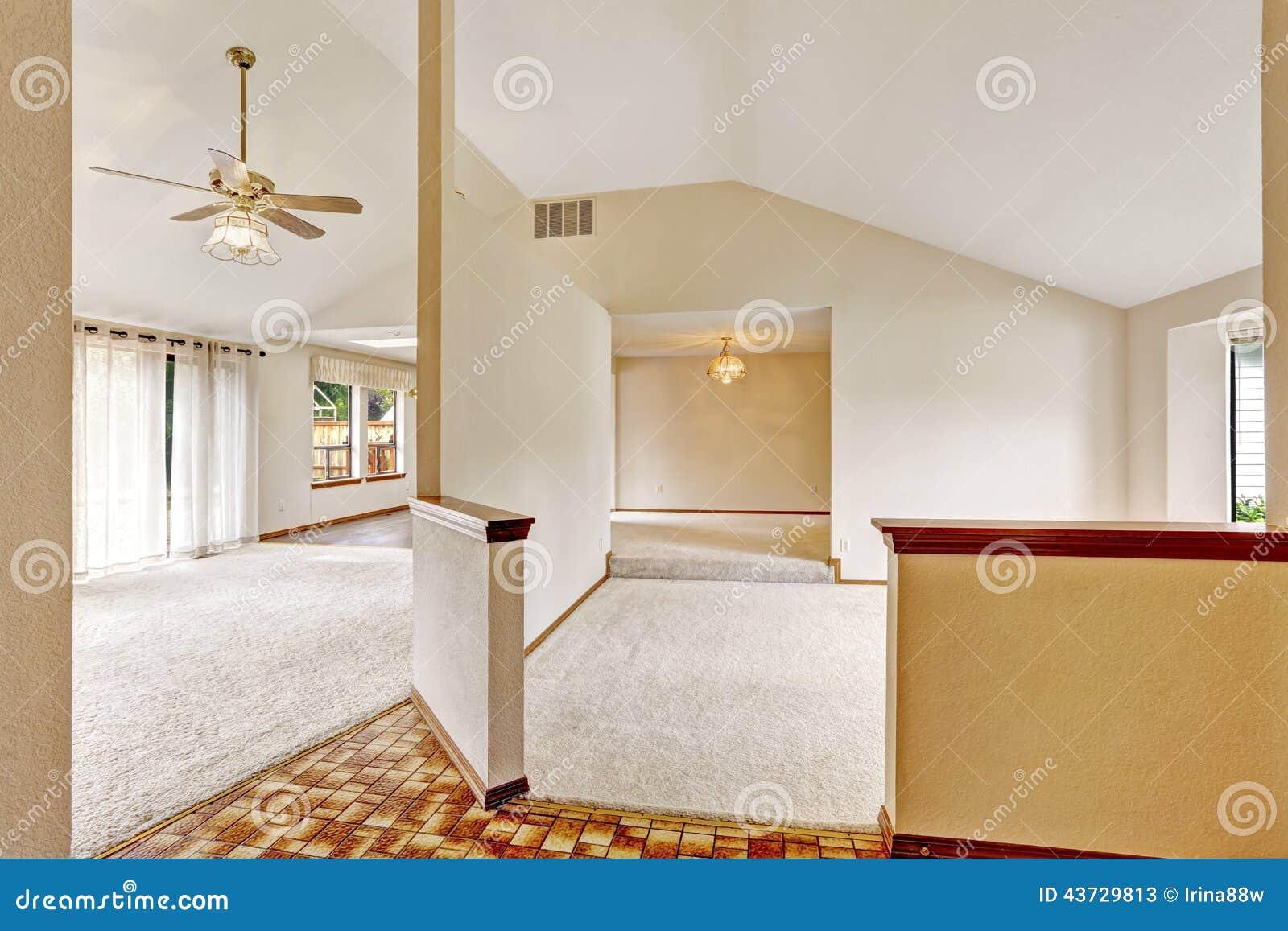 Open floor plan in empty house with vaulted ceiling stock for Open floor plans with vaulted ceilings