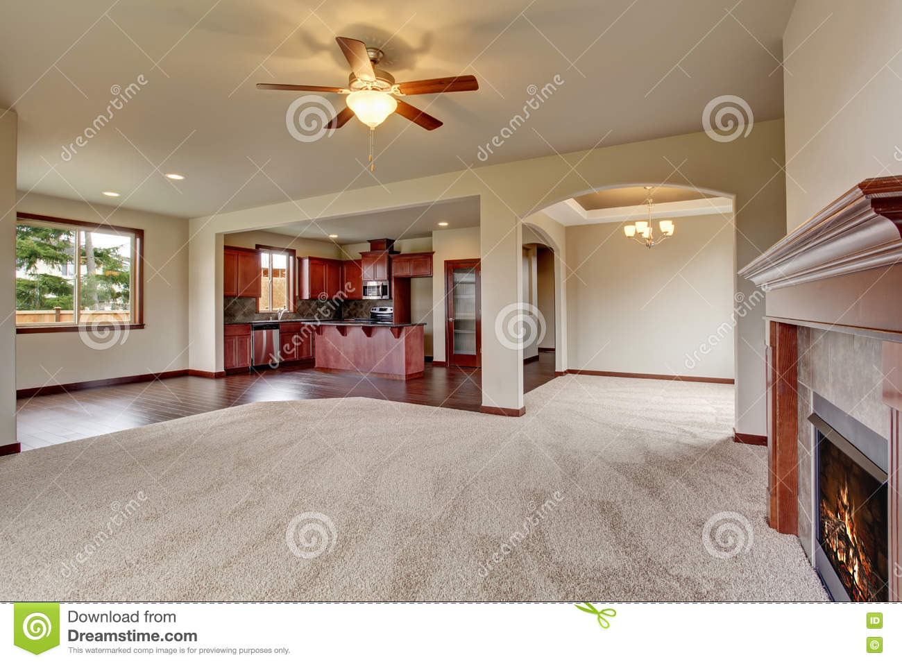 open floor plan interior with carpet and fireplace stock photo floor