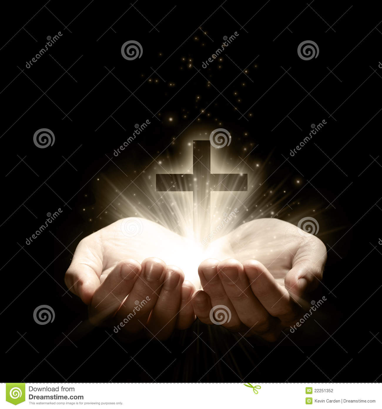 Hands Holding Christian Cross With Light Beams Stock Photo