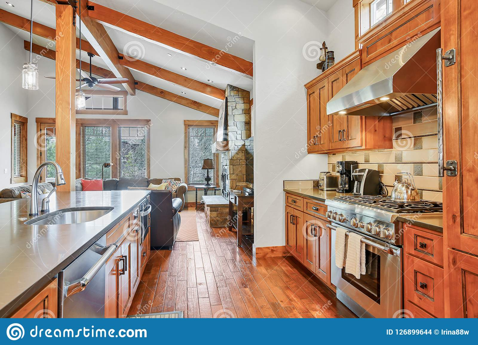 Open Kitchen Design With Vaulted Ceiling And Hardwood Floor Stock Photo Image Of Ceiling Stove 126899644