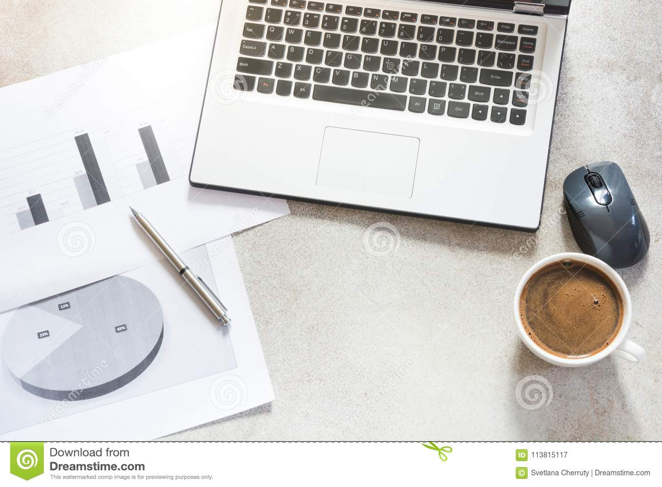 Open laptop, documentation, reports, planning and cup of black coffee. Top view with copy space. Office business concept. Working