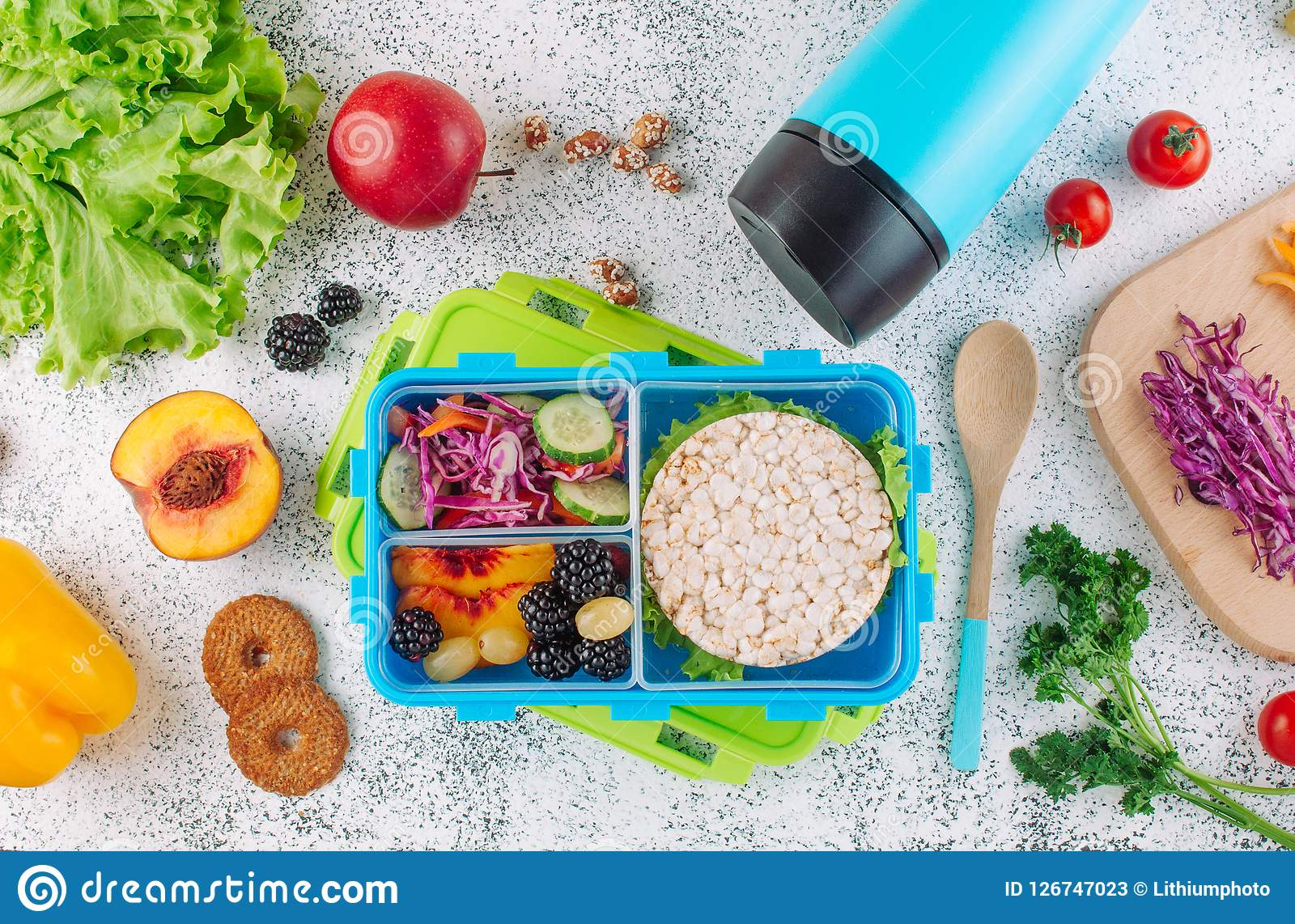 Open Lunch Box With Crispbreads Fruits And Vegetables And