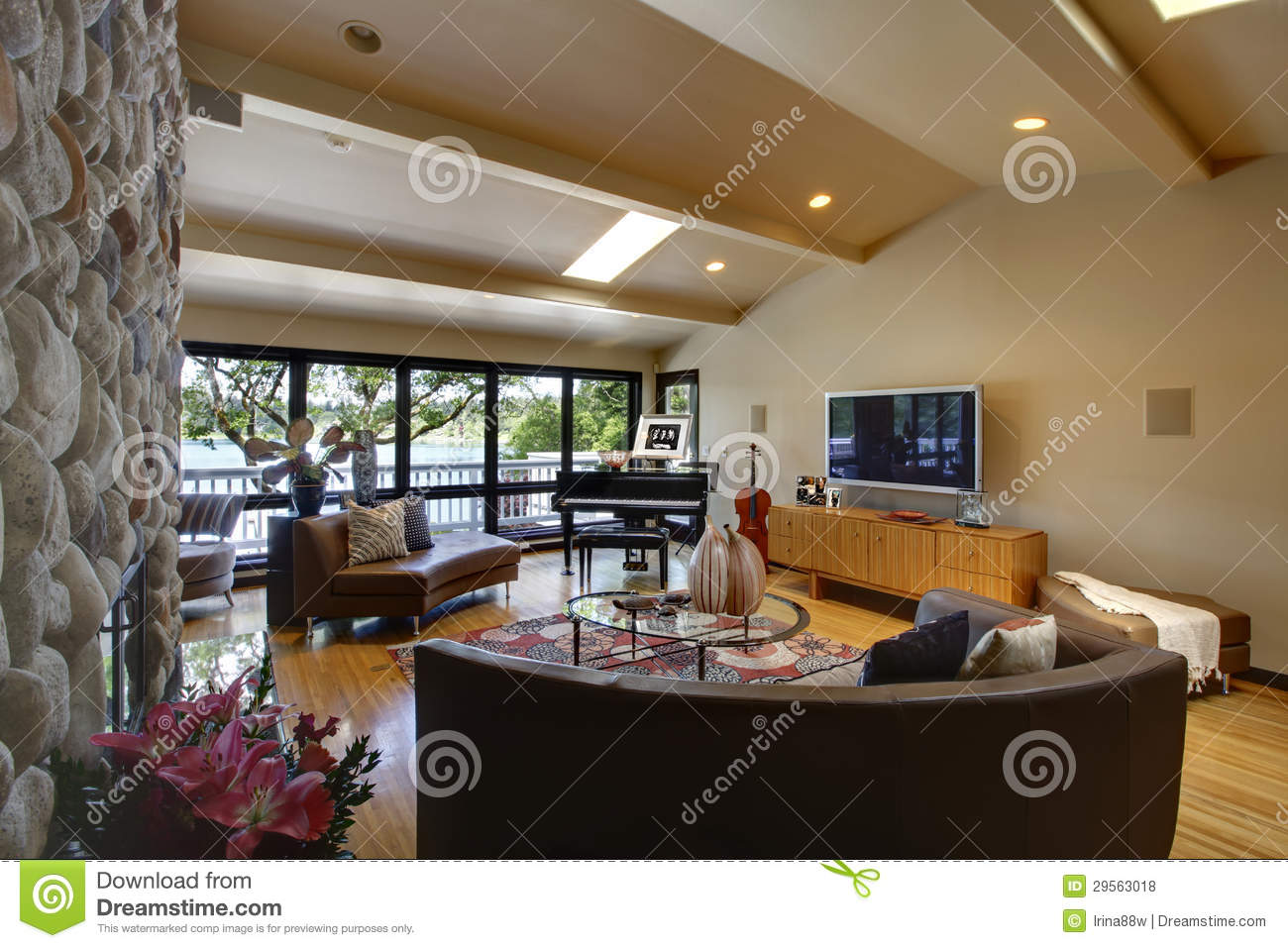 ... luxury home interior living room and stone fireplace. Vaulted ceiling
