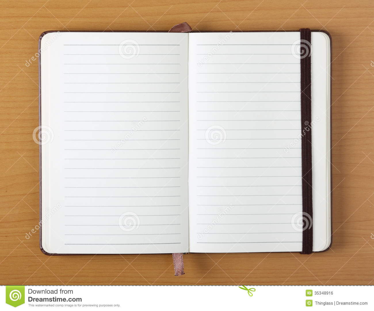Open Notebook On Wood Background Royalty Free Stock Image
