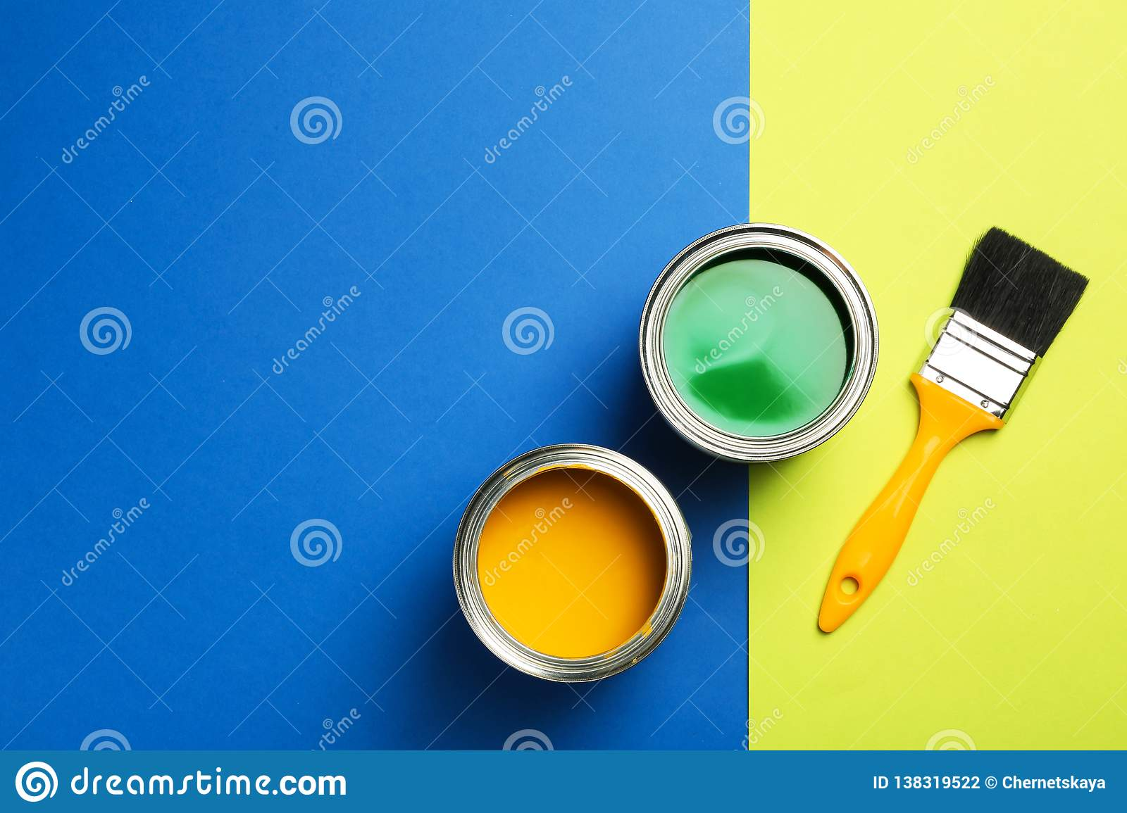 Open paint cans, brush and space for text on color background