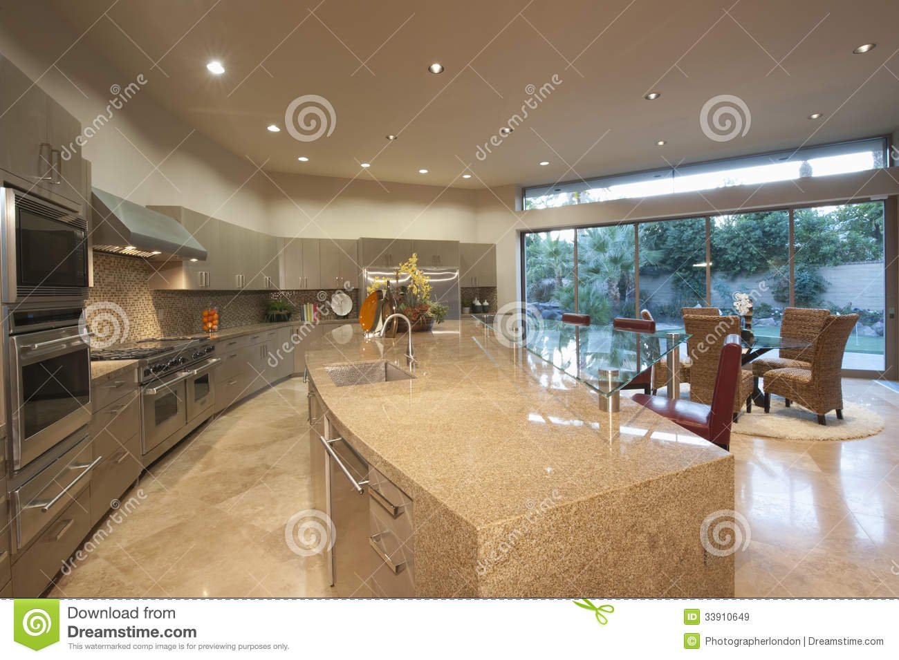 Open plan kitchen with dining area royalty free stock for Pictures for dining area