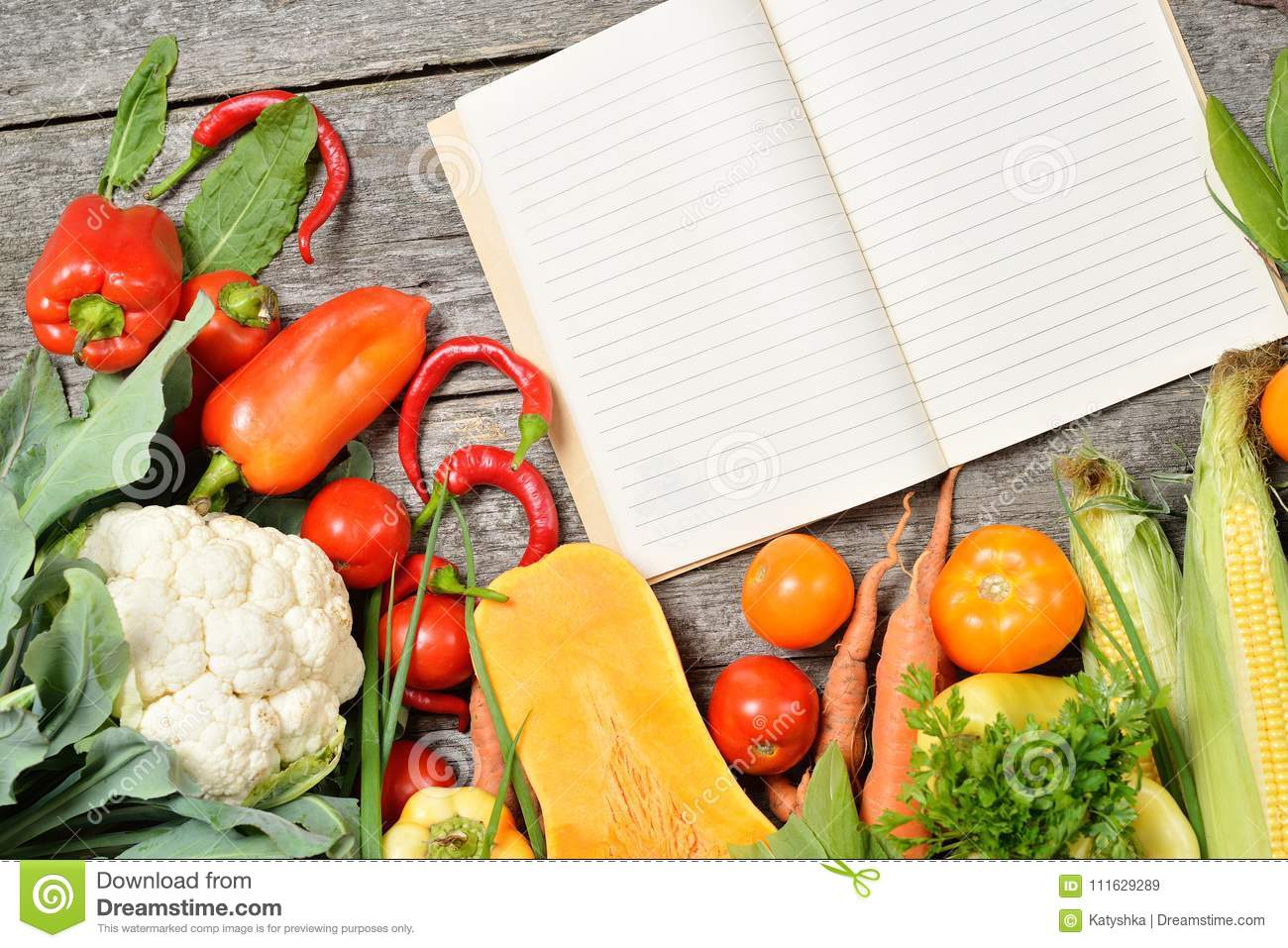 Open recipe book with set of raw organic vegetables on vintage royalty free stock photo download open recipe book with set of raw organic forumfinder Images