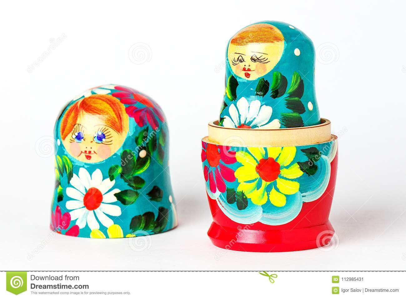 Open Russian handmade doll on a white background