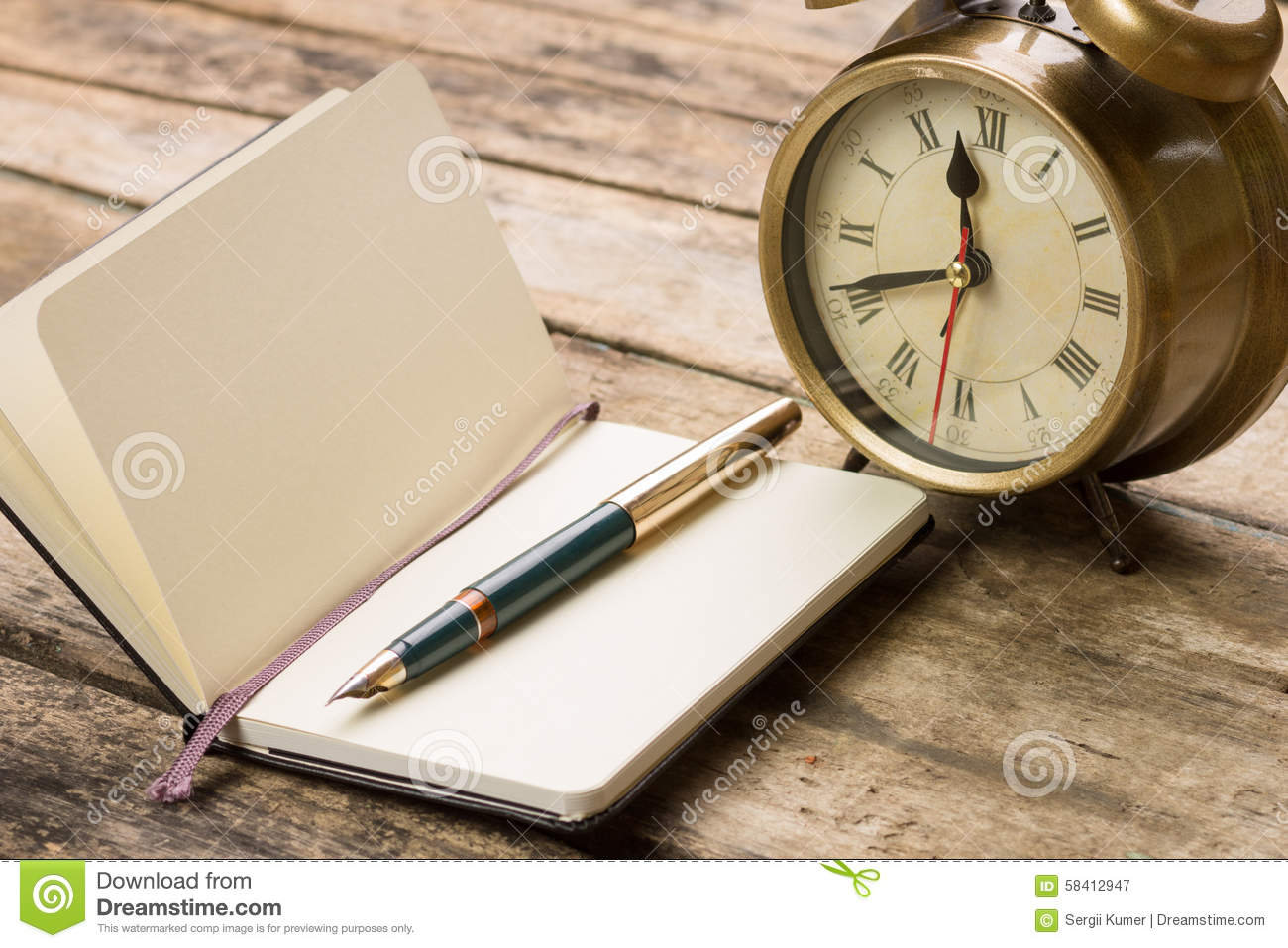 Open Small Notebook With Fountain Pen And Old Fashioned Alarm Clock Behind  Royalty Free Stock