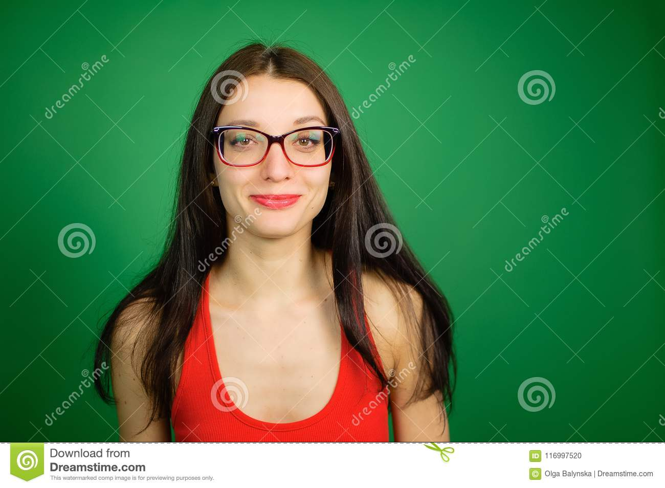 d85033ab5cda Studio Portrait of Cute Smart Girl in Eyeglasses and Red Top on Green  Background.
