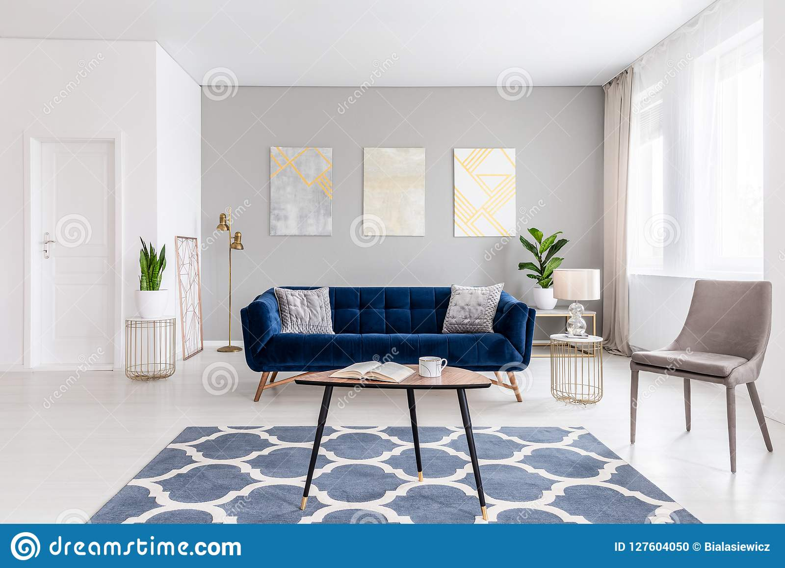 . Open Space Living Room Interior With Modern Furniture Of A Navy Blue