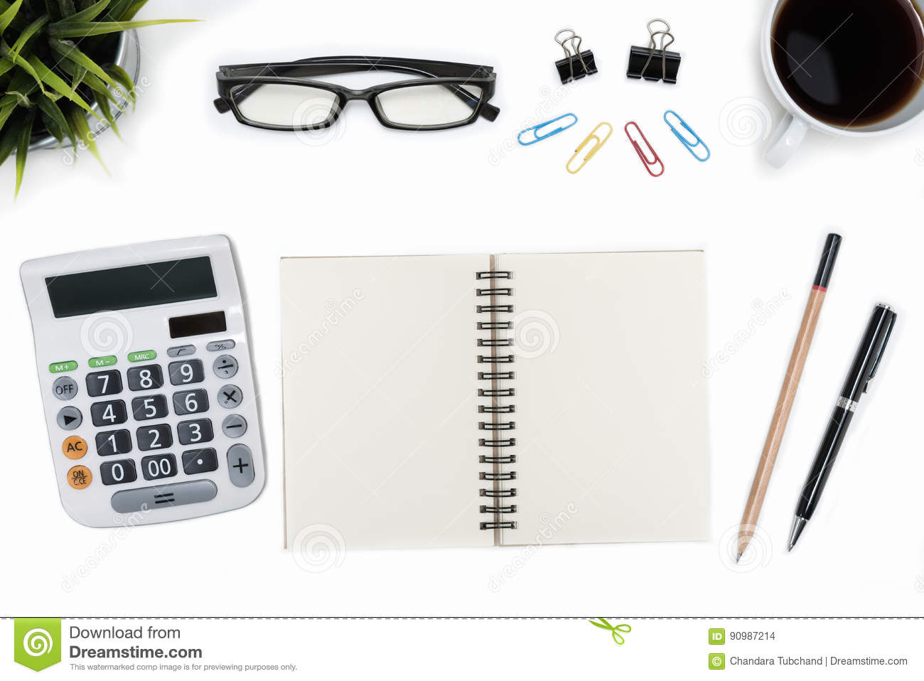 open spiral blank notebook and calculator on white desk table stock