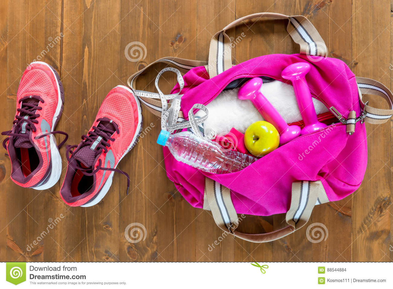 6bf177573a Open Sports Bag And Pink Running Shoes On A Wooden Floor Stock Photo ...