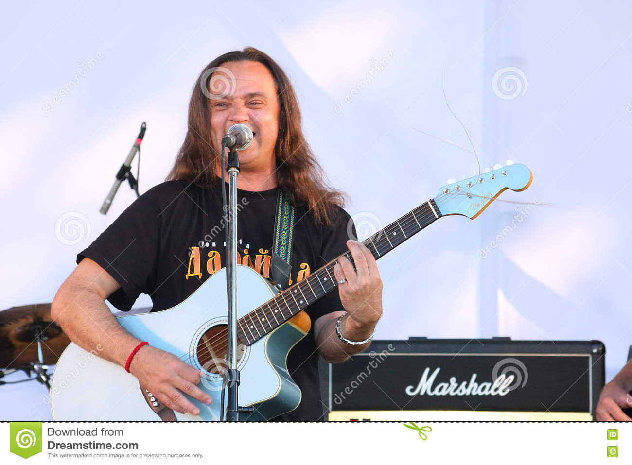On the open stage of the festival are musicians in a rock band, Darida.