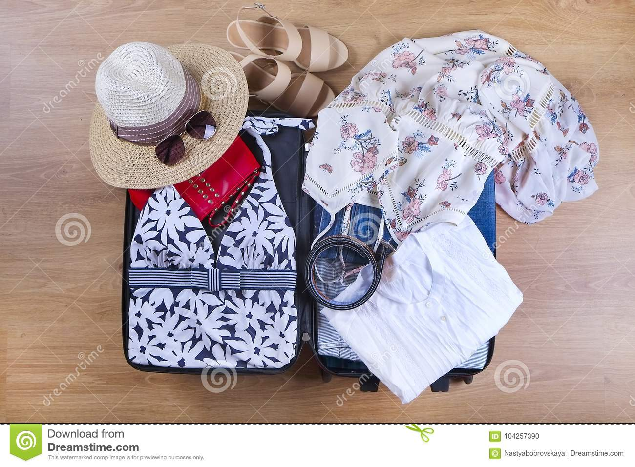 Open Suitcase With Casual Female Clothes Hat, Sunglasses