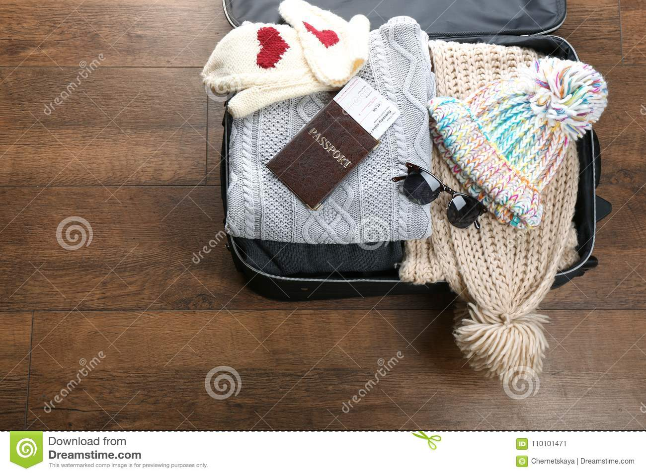941c8db7093 Open Suitcase With Warm Clothes And Documents Stock Image - Image of ...