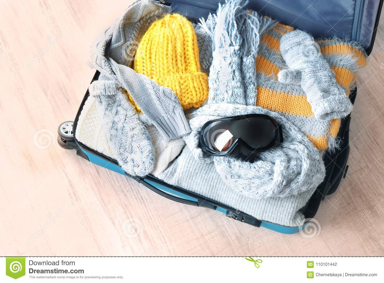 1831527c8c9 Open Suitcase With Warm Clothes And Ski Goggles Stock Photo - Image ...
