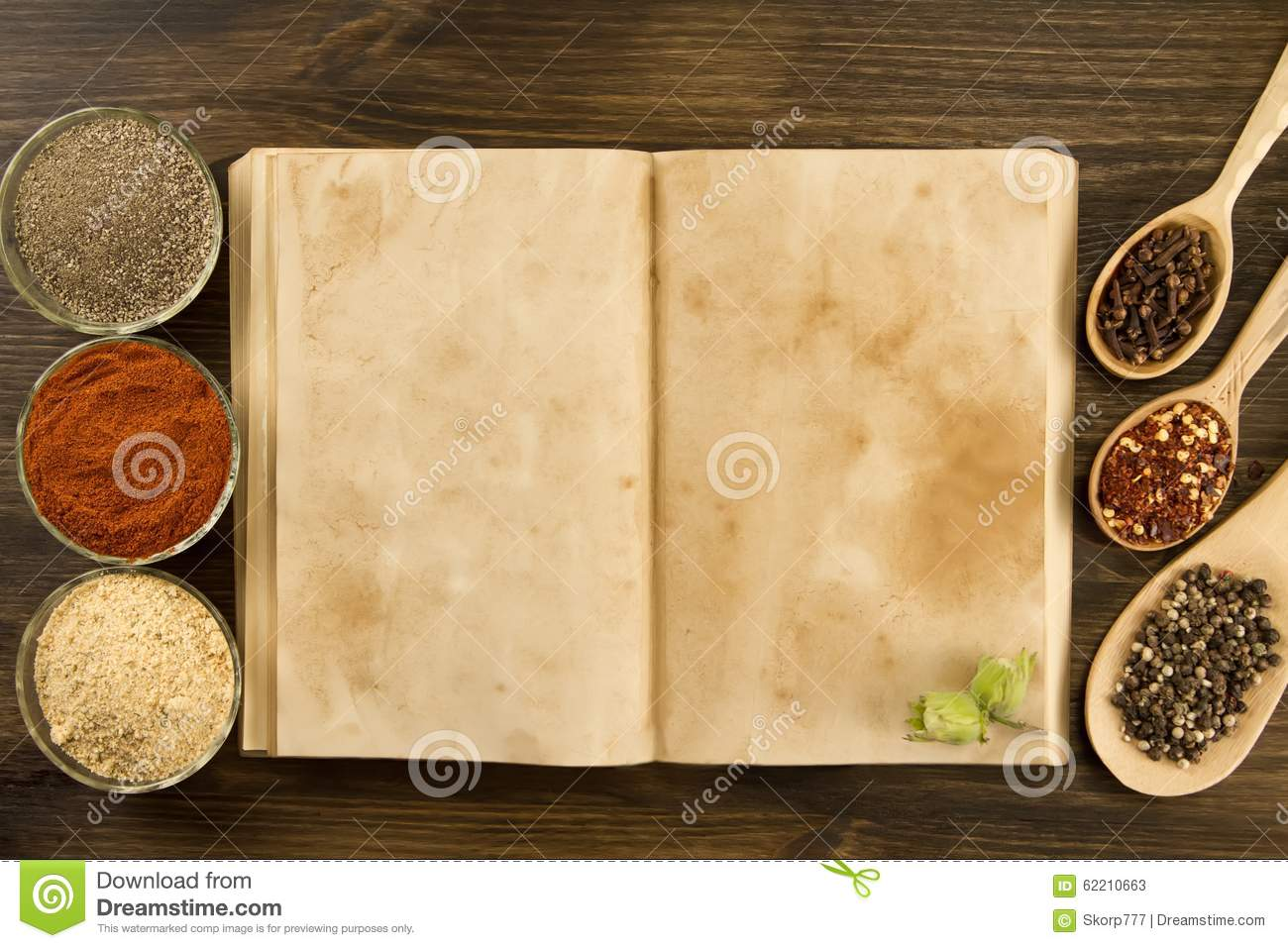 Open vintage book with spices on wooden background healthy download comp forumfinder Gallery
