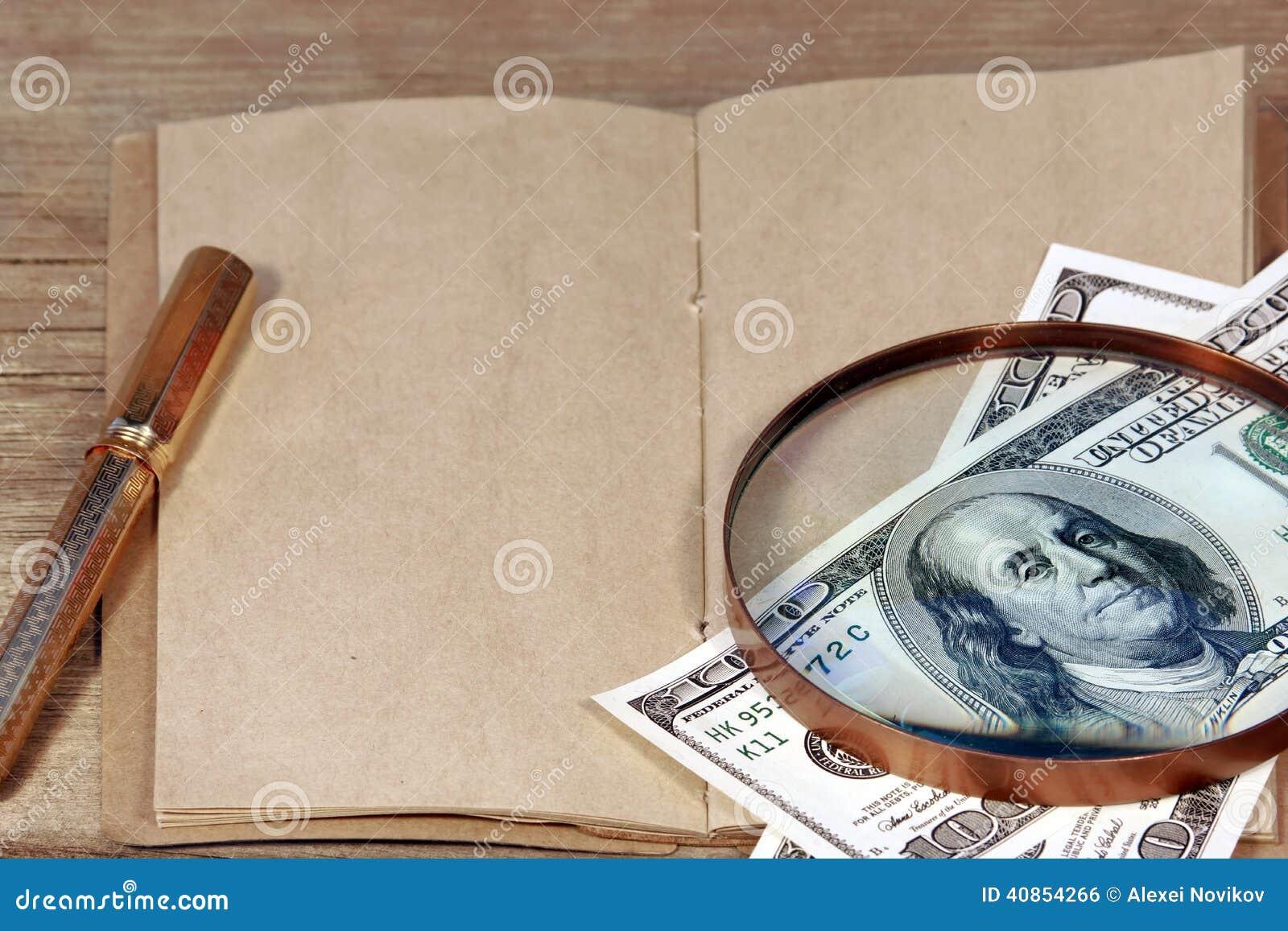 Open Vintage Notepad And Hundred Dollar Bill Under
