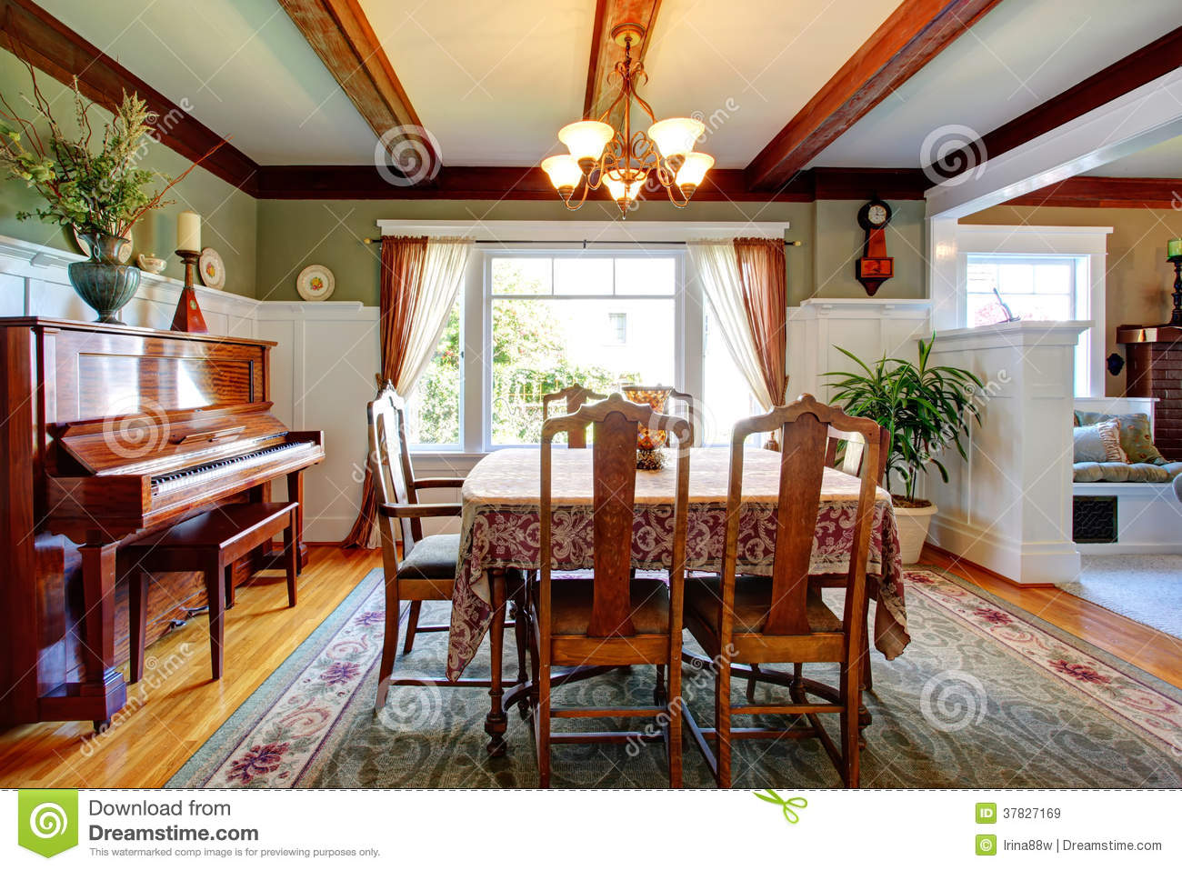 Open Wall Design Dining Room With Piano Stock Image