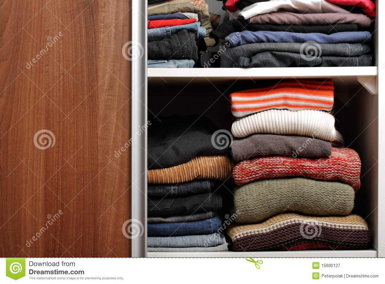 Open Wardrobe With Lots Of Folded Clothes Royalty Free