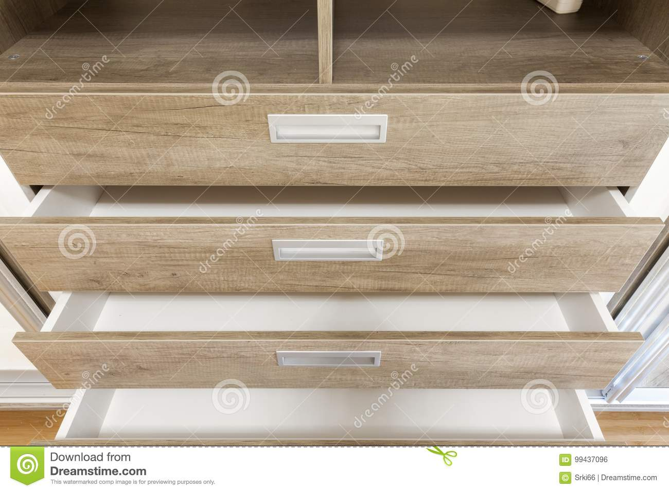 Open wooden drawers in the closet