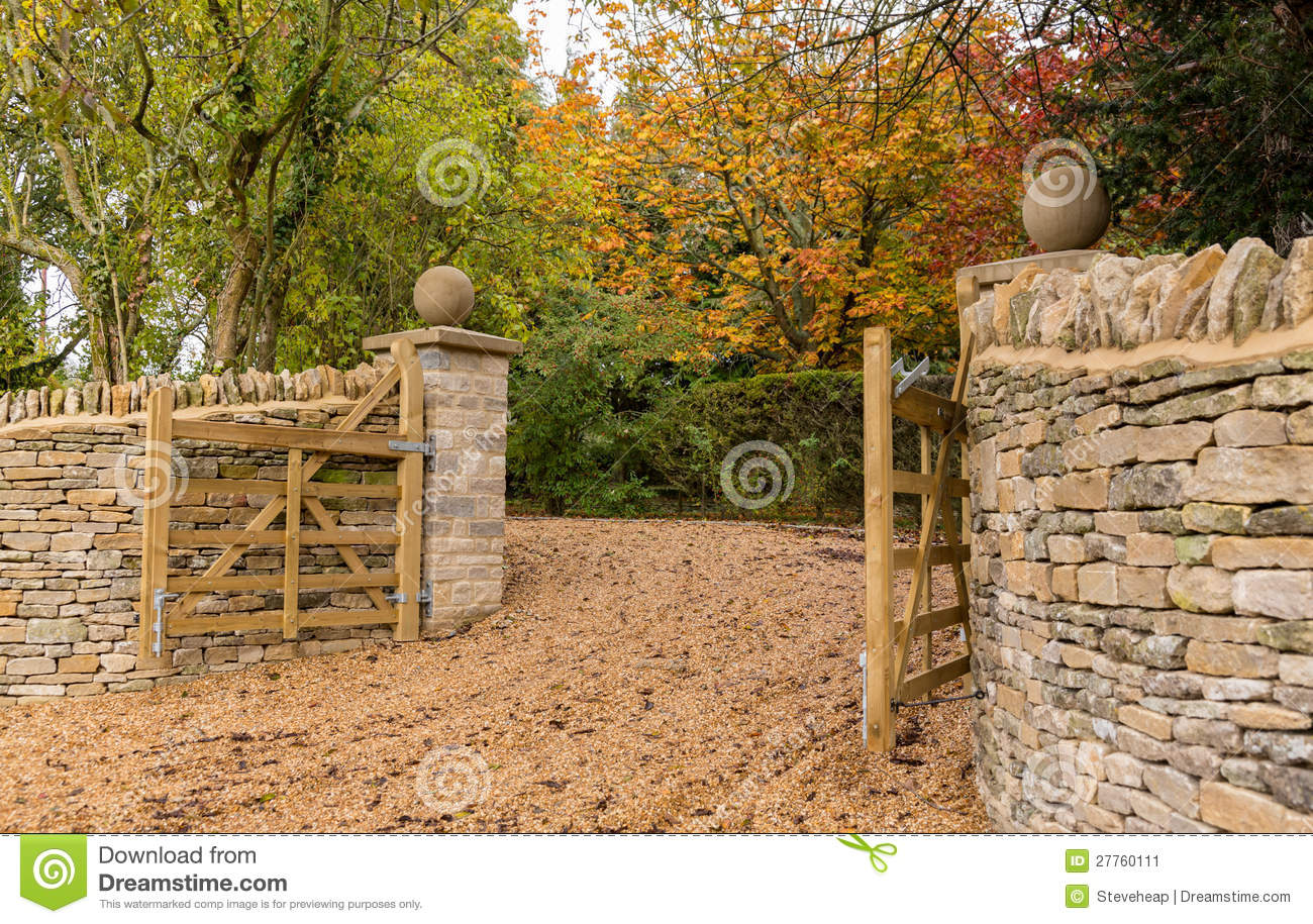 Open Wooden Gates At Entrance To Modern House Stock Image