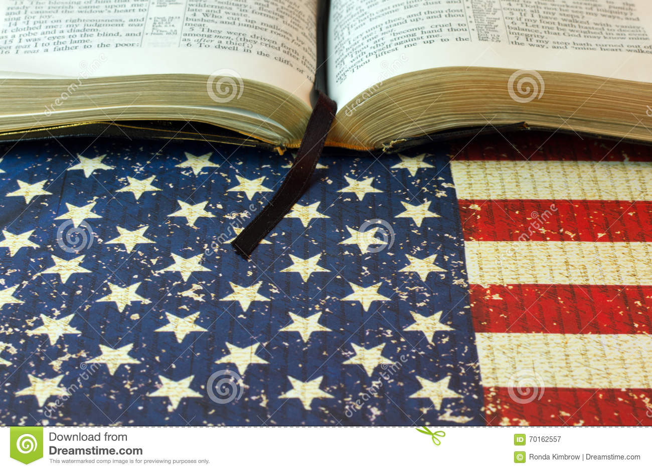 68e5587651d7 An Opened Bible on an American Flag Background. The bookmark hangs out of  an opened